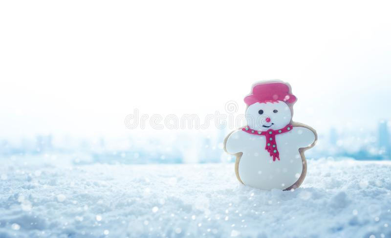 Christmas festival concepts ideas with snowman cookie on snow. Copy space royalty free stock photo