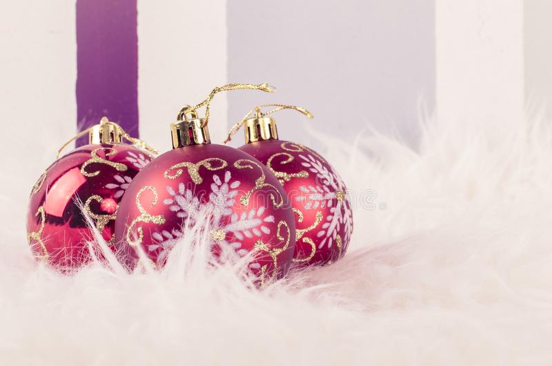 Christmas festival decoration with red ornament ball on fluffy white rug. royalty free stock photography