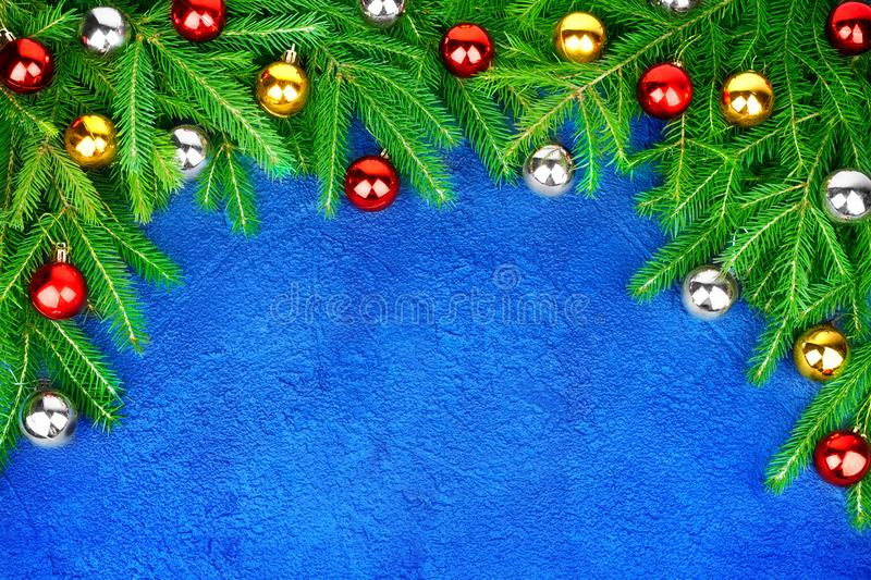 Christmas festive border, New Year decorative frame, shiny golden, silver, red balls decorations on green pine branches stock images