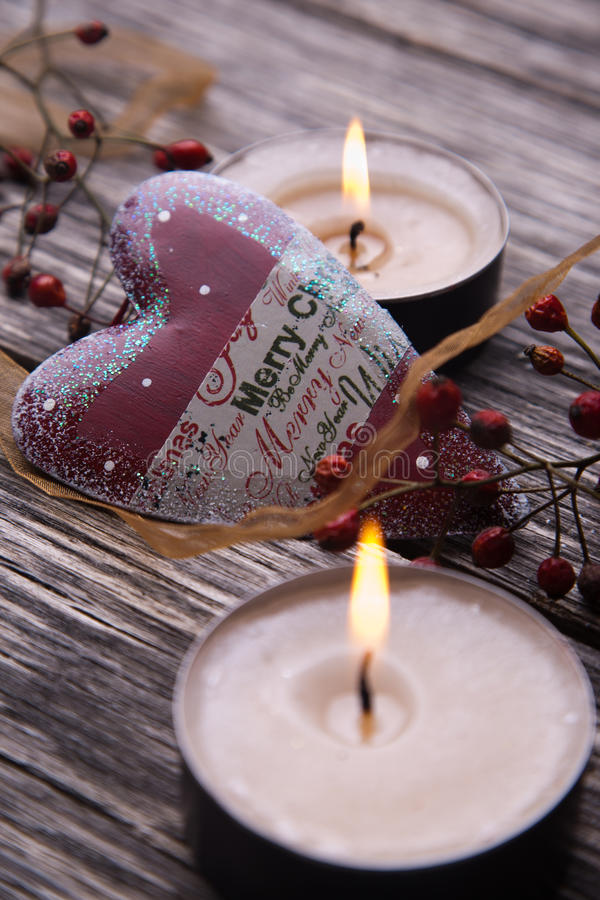 Christmas festive candles with Christmas balls stock photo