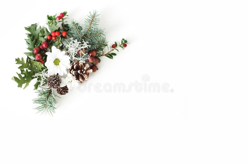 Christmas festive floral composition. Pine cones, fir, tree branches, oak leaves, red rowan berries and chrysanthemum royalty free stock photos