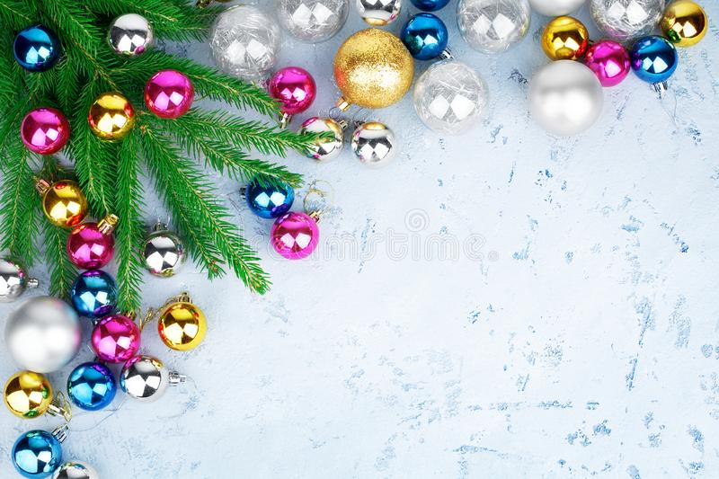 Christmas festive frame, New Year decorative border, gold, silver, pink balls decorations, green fir branches on blue royalty free stock photography