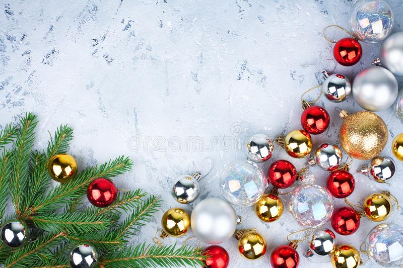 Christmas festive frame, New Year decorative border, shiny gold, silver, red balls decorations on green fir branches royalty free stock photography