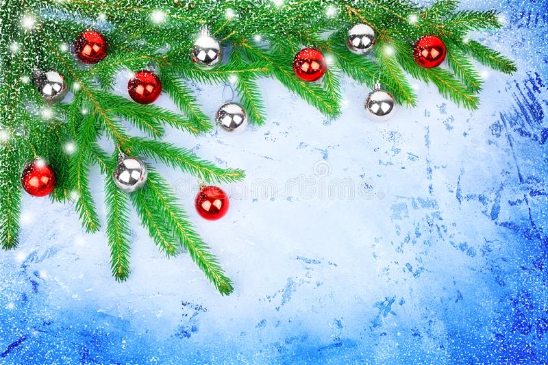 Christmas festive frame, New Year decorative border, shiny silver and red balls decorations, green pine branches, frosty backdrop. Christmas festive frame, New stock photo