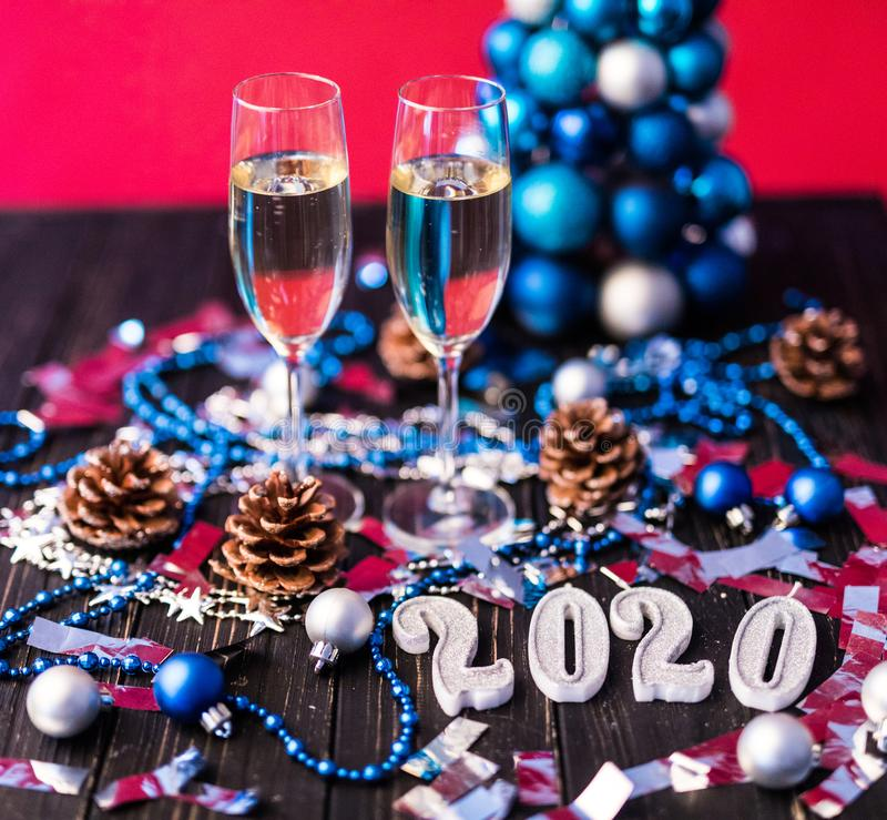 Christmas, festive mood: glass of champagne and New Year`s 2020 decoration. Christmas, festive mood: glass of champagne and New Year`s decoration stock photography