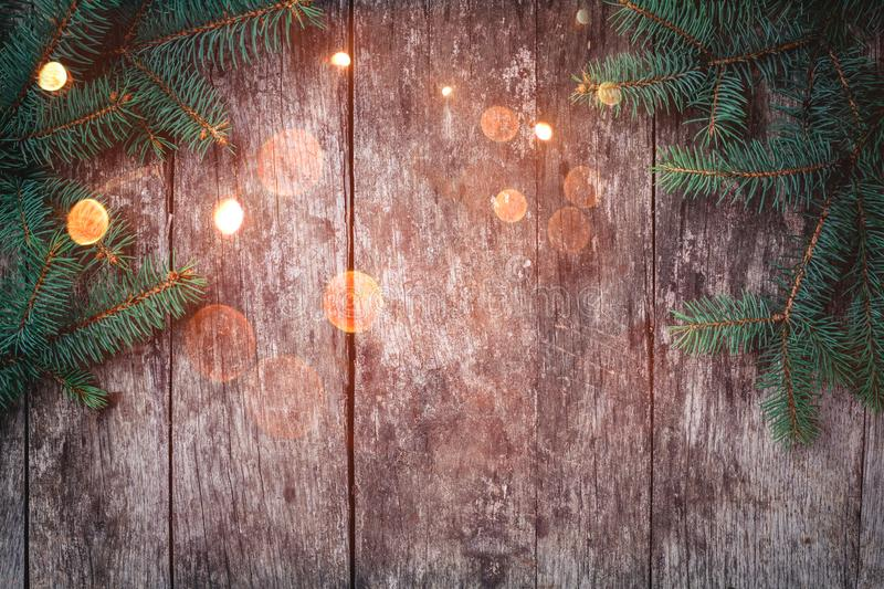 Christmas Fir branches on wooden background. Xmas and Happy New Year composition. Flat lay, top view. Copy space royalty free stock images