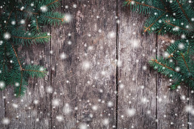 Christmas Fir branches on wooden background. Xmas and Happy New Year composition. stock photo