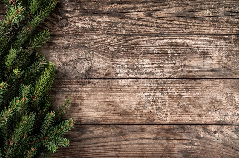 Christmas fir branches on wooden background. Xmas and New Year theme. royalty free stock photo