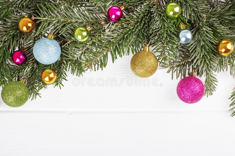 Christmas fir tree with balls on wooden board background w. Christmas fir tree with balls on white wooden board background with copy space stock image