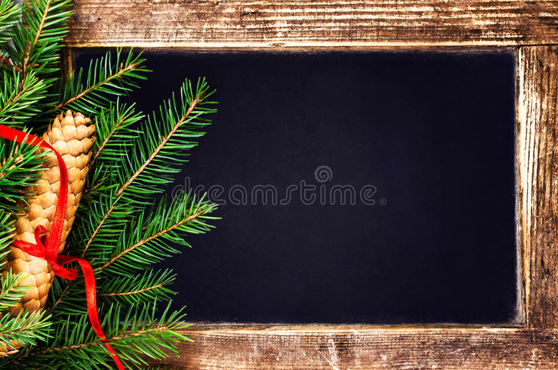 Download Christmas  Fir Tree Branch And Pine Cone On  Vintage Blackboard Stock Image - Image: 35660821