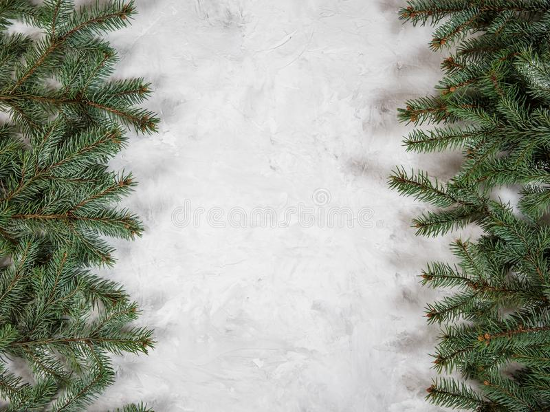 Christmas fir tree branch on stone background. Xmas backdrop. For your greeting card with space for text royalty free stock photo