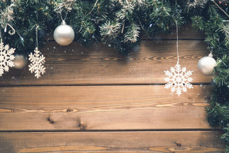 Christmas fir tree branches with decorations on a wooden board with snow. Top view with free space for your text royalty free stock photos