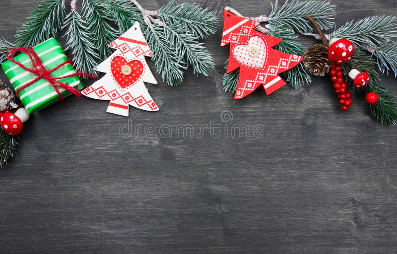 Christmas fir tree with decoration on dark wooden board. A Christmas fir tree with decoration on dark wooden board royalty free stock photos