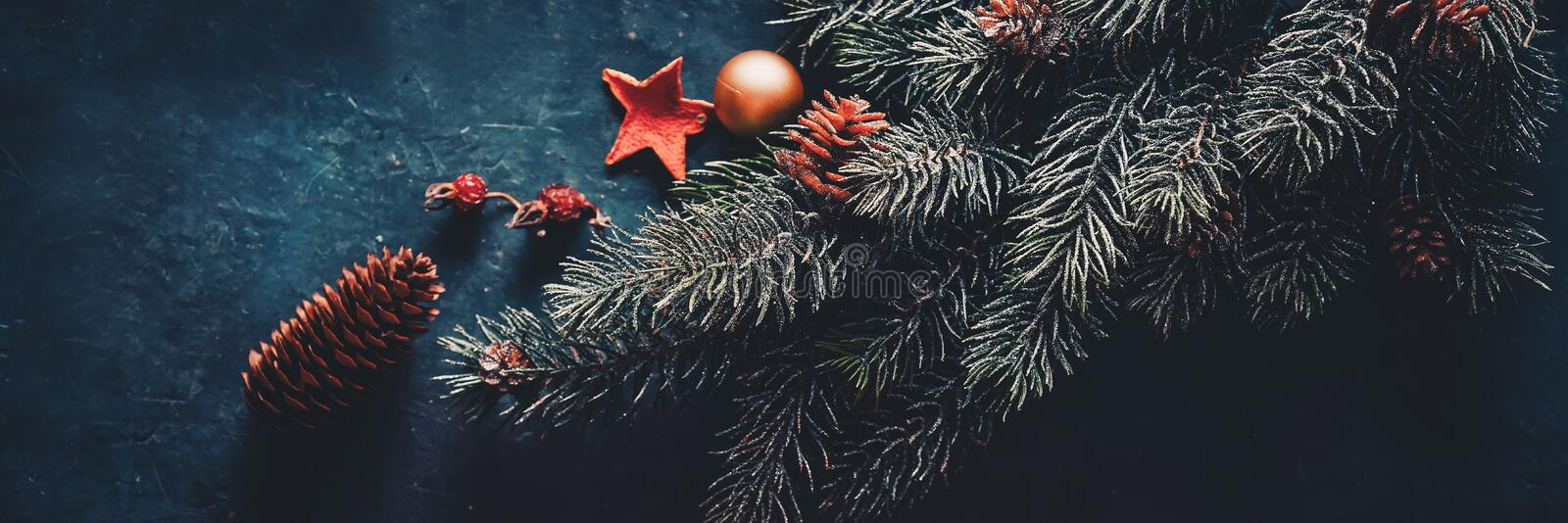 Christmas fir tree, decorations on a dark background. Banner stock photos