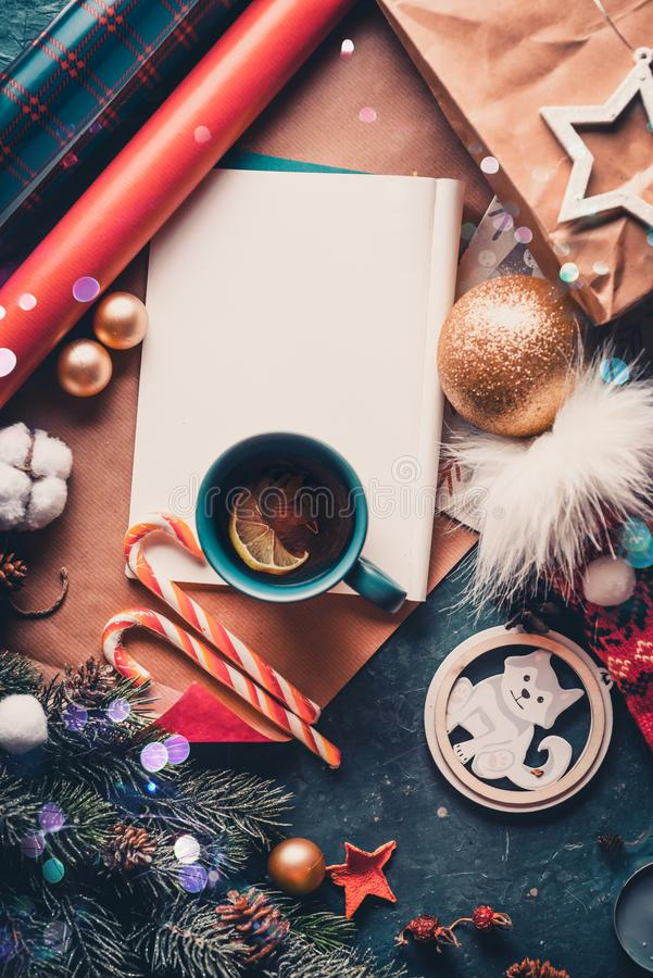 Christmas fir tree, decorations and hot tea with lemon. A letter to Santa Claus. View from above royalty free stock photo