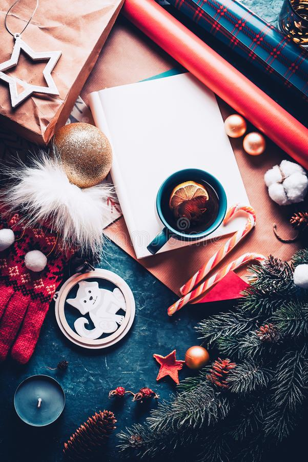 Christmas fir tree, decorations and hot tea with lemon. A letter to Santa Claus. View from above stock photography