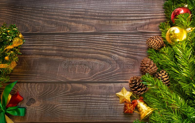 Christmas fir tree, festive. Composition decorations and xmas gift boxes on dark wooden board background. Celebration for holiday stock images