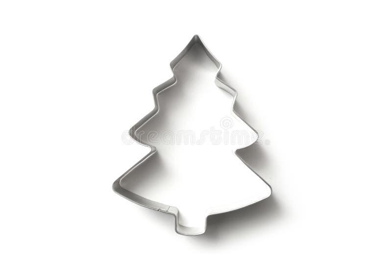 Christmas fir tree shape cookie cutter on white backg. Closeup of Christmas fir tree shape cookie cutter on white background stock image