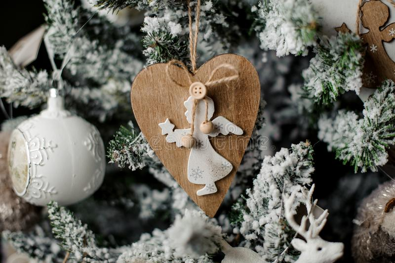 Christmas fir tree toy in shape of hearth with an angel figure royalty free stock photo