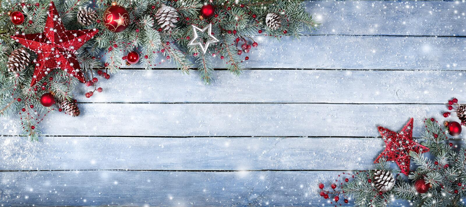 Christmas Fir Tree On Wooden Background. With Snowflakes stock images