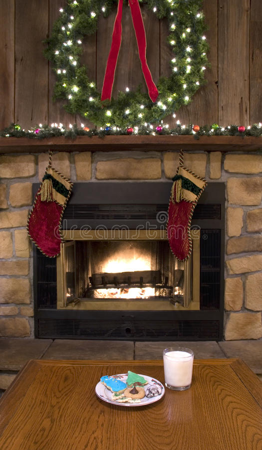 Christmas Fireplace Hearth with Cookies and Milk for Santa stock photos