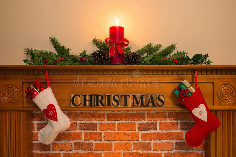 Christmas fireplace with stockings and candle royalty free stock image