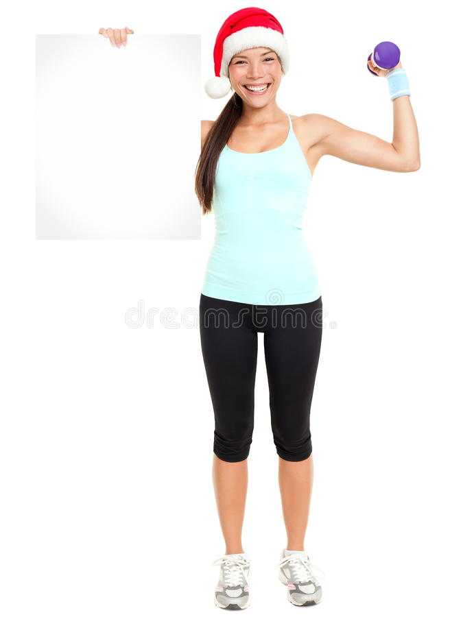 Christmas Fitness woman showing sign stock images