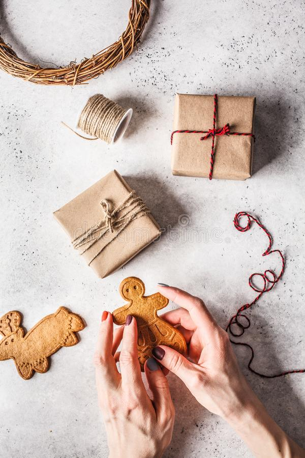 Christmas flat lay with gifts boxes, garland and ginger cookies. Christmas background stock photography