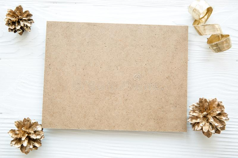 Christmas golden cones on white table, space for text greeting stock photo