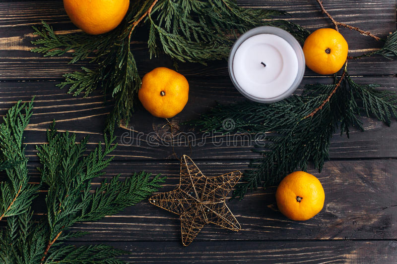 Download Christmas Flat Lay Wallpaper With Green Branches And Oranges Stock Photo