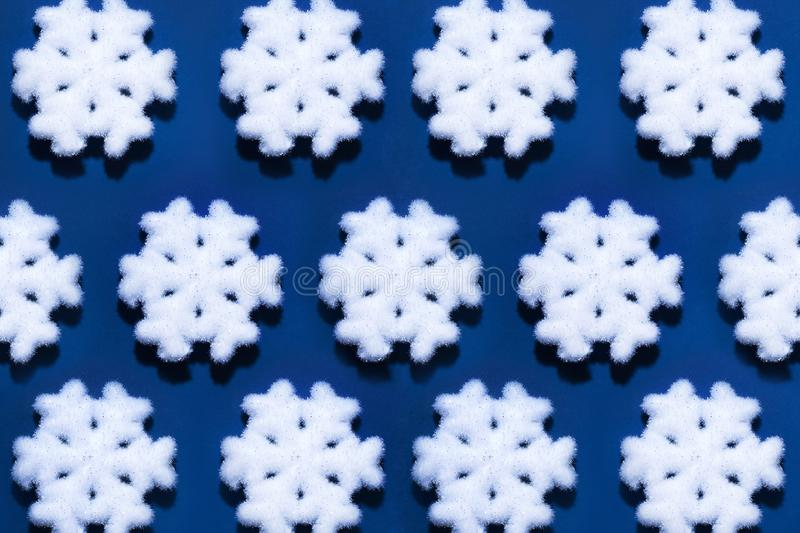 Christmas flatlay with snowflake. Christmas pattern with white snowflake isolated on blue background royalty free stock image