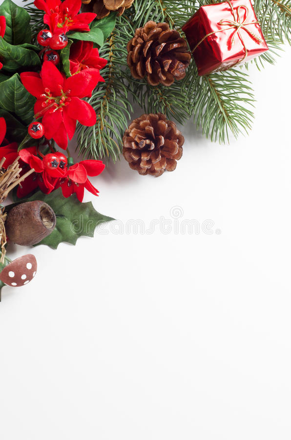 Christmas Flora Corner Border. A Christmas themed border running diagonally from mid-left to upper right of frame consisting of a variety of artifical flora stock images