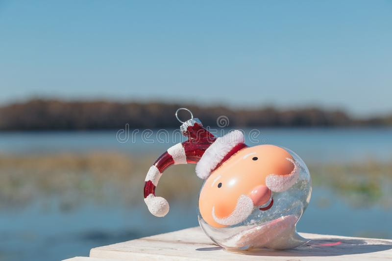 Christmas in Florida theme, santa bulb  on a beach at Lake Louisa State Park in Clermont, Florida. Christmas in Florida concept, santa ornament on a beach at royalty free stock photo