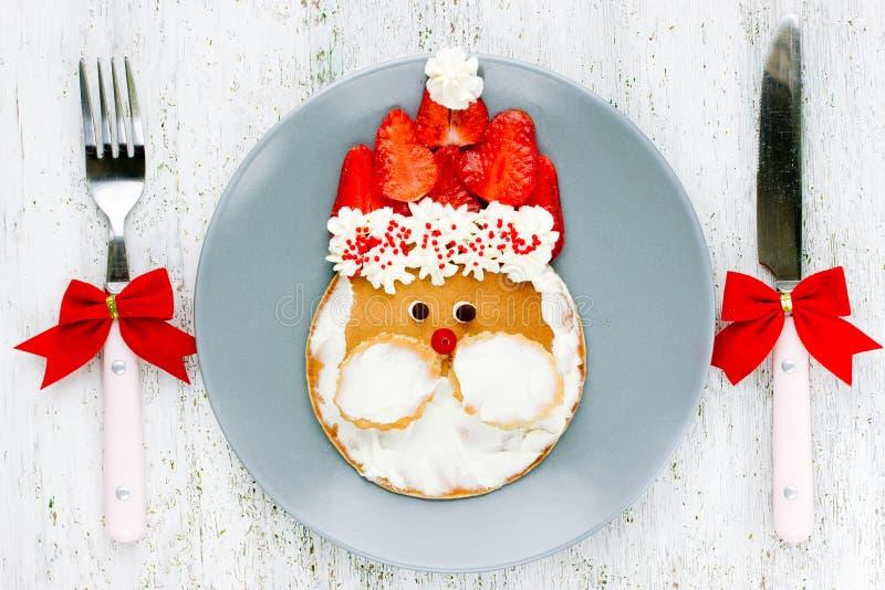 Christmas food art idea for kids - Santa pancakes for breakfast. Christmas food art idea for kids - Santa pancakes for delicious and healthy breakfast royalty free stock photo