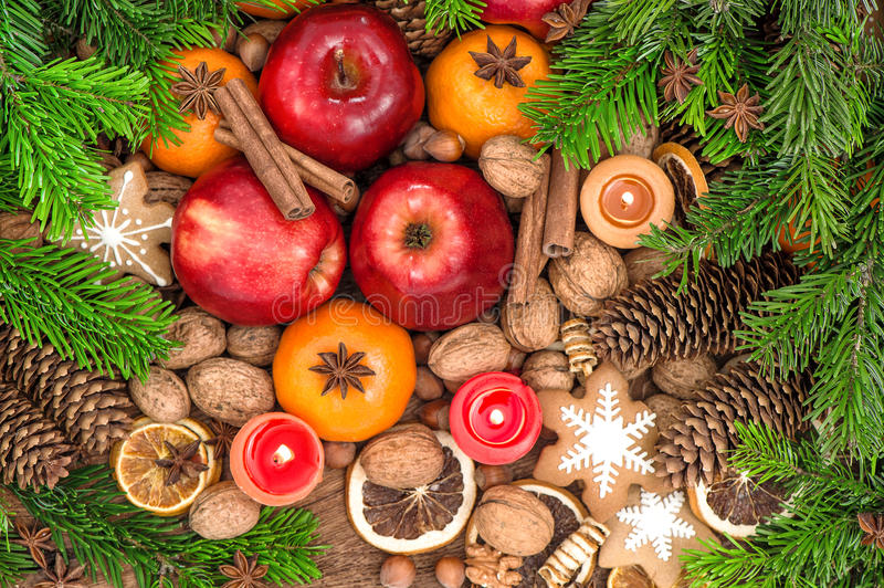 Christmas food backdround. Fruits, cookies, spices and nuts. Top view royalty free stock photos