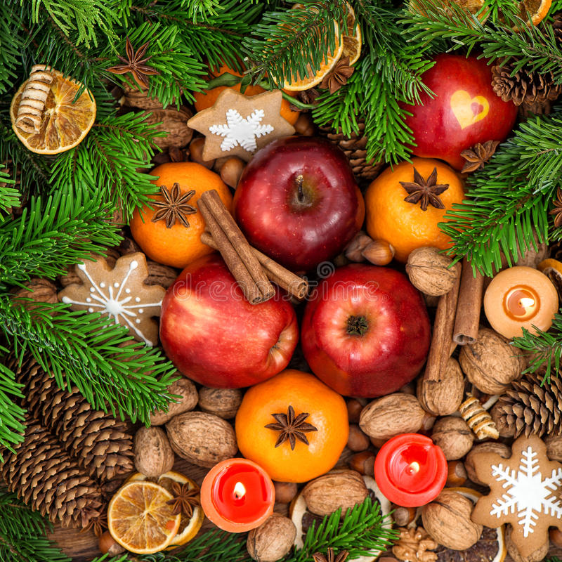 Christmas food backdround. Fruits, nuts, spices and cookies. Top view royalty free stock photography