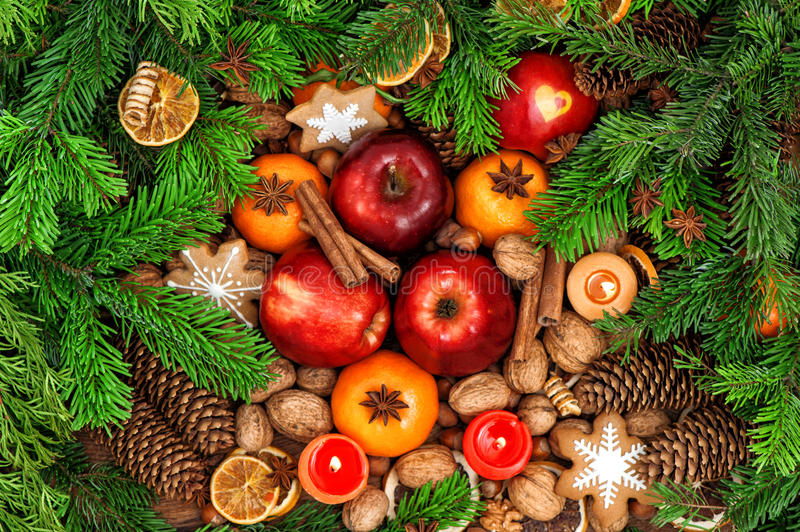 Christmas food backdround. Fruits, spices and cookies. Christmas food backdround. Fruits, nuts, spices and cookies. Top view. Vibrant colors royalty free stock photography