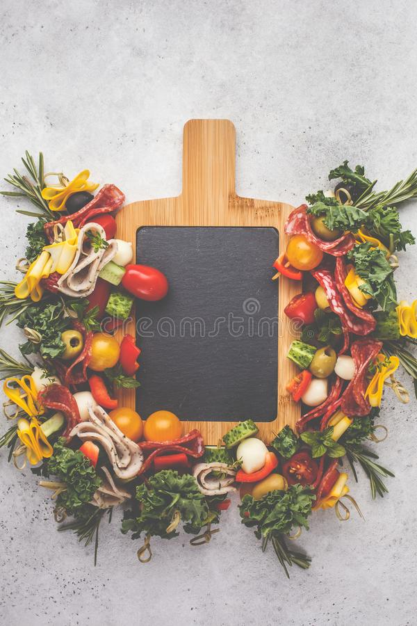 Christmas food background. Christmas festive snack on a serving chalkboard, white background stock photos