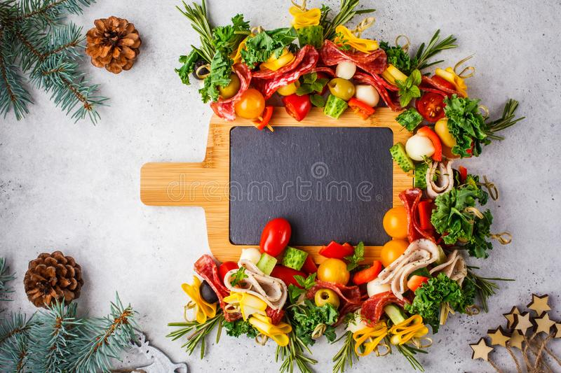 Christmas food background. Christmas festive snack on a serving chalkboard, white background royalty free stock photo