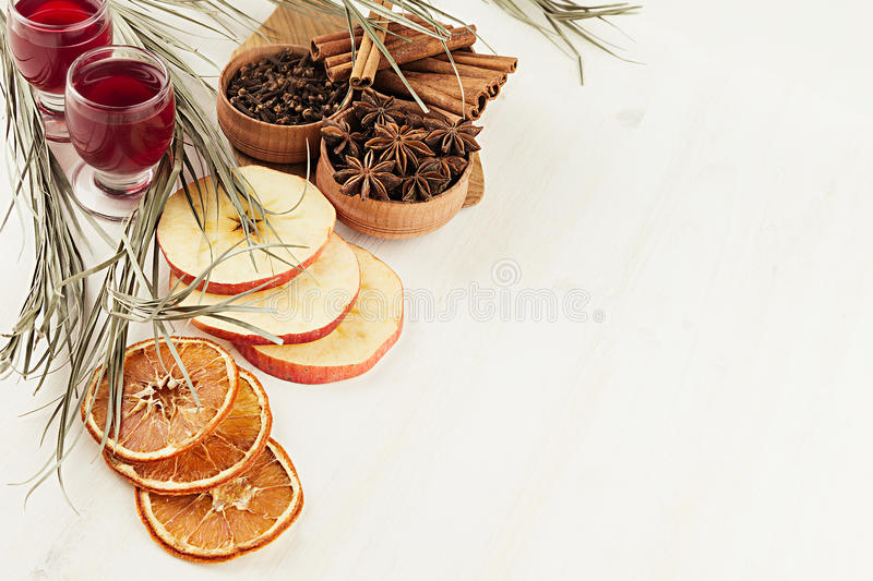 Christmas food background - mulled wine. Decorative border of spices and drinks on white wood board. Top view. Cooking of beverage stock photography