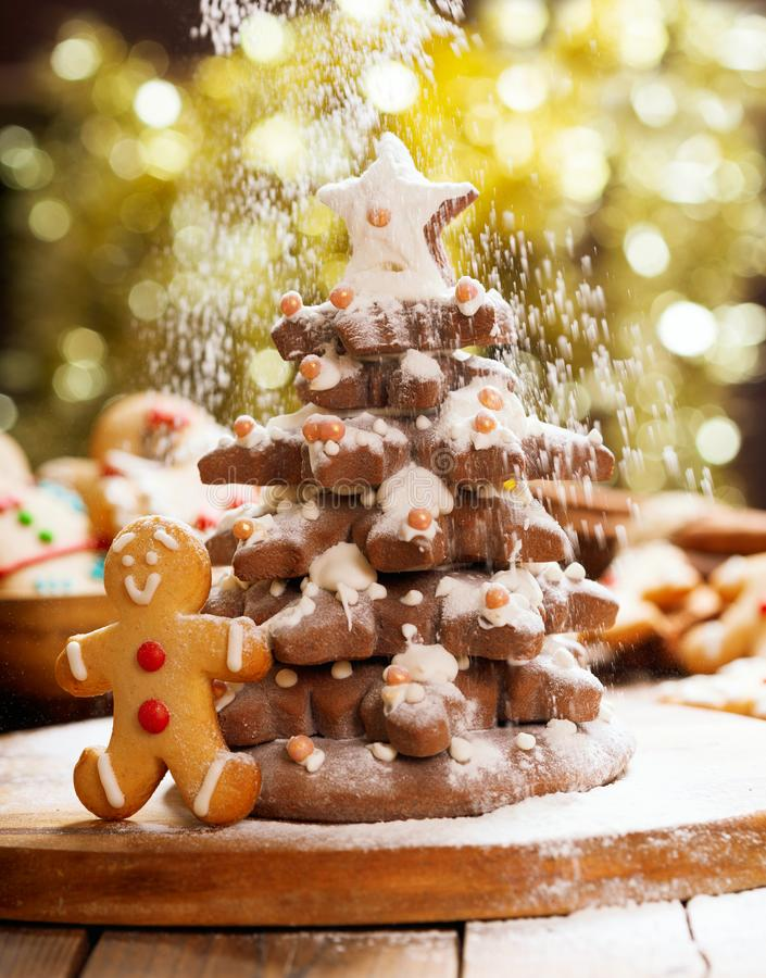 Christmas food. Christmas Tree made from Gingerbread cookies and snow from icing sugar stock images