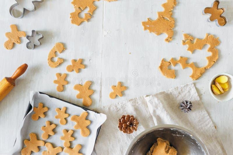 Christmas food Raw dough for cooking gingerbread man cookies in Christmas. Christmas food concept. Raw dough for cooking gingerbread man cookies in Christmas on royalty free stock photos