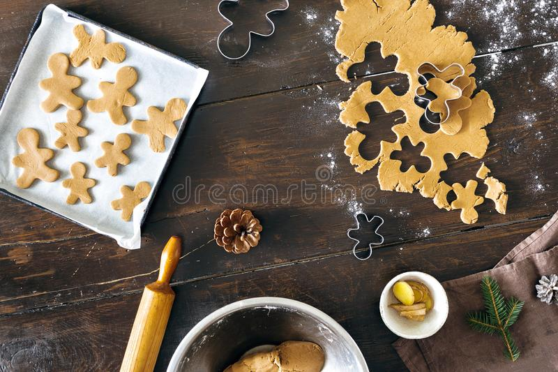 Christmas food concept. Raw dough for cooking gingerbread man cookies in Christmas royalty free stock photography