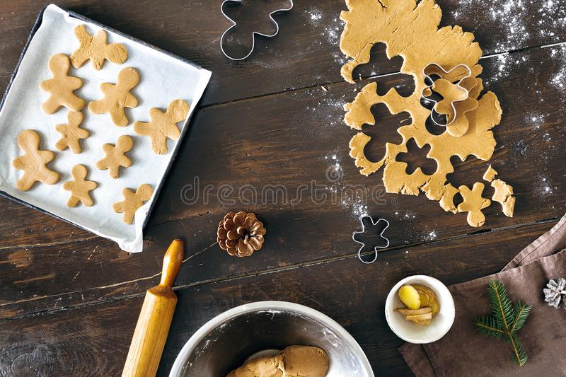 Raw dough for cooking gingerbread man cookies in Christmas. Christmas food concept. Raw dough for cooking gingerbread man cookies in Christmas on wooden table stock images