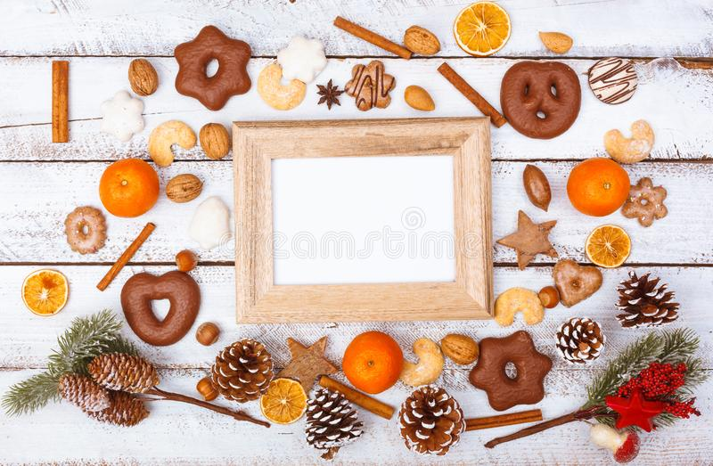 Christmas food flat lay with photo frame on white table royalty free stock photo
