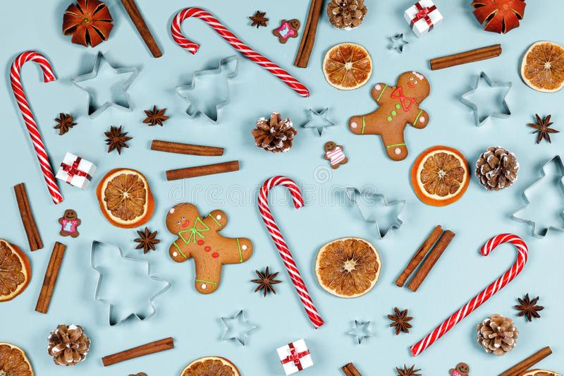 Christmas food frame. Gingerbread cookies, spices and decorations on blue background with copy space royalty free stock photography
