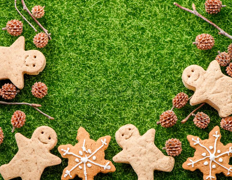 Christmas food. Gingerbread man cookies in Christmas setting. Xmas dessert stock photography