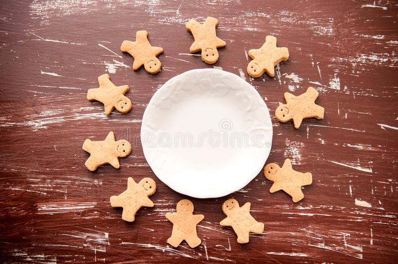 Christmas food. Gingerbread man cookies in Christmas setting. Xmas dessert royalty free stock photography