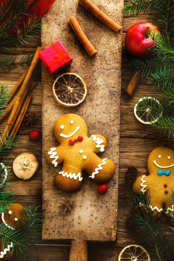 Gingerbread man on wood. Christmas food. Gingerbread man cookies in Christmas setting. Xmas dessert stock image