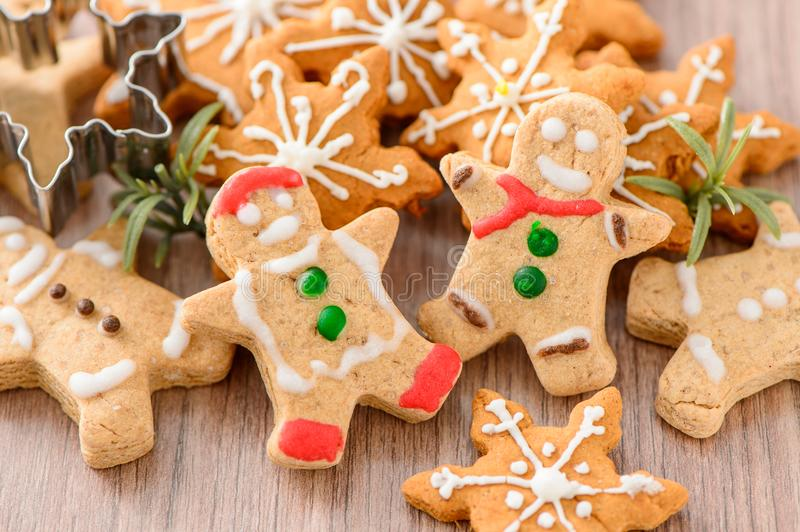 Christmas food. Gingerbread man and gingerbread star cookies in Christmas setting. Xmas dessert stock image